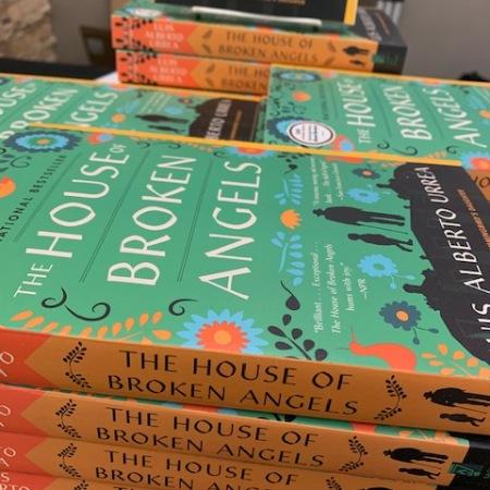 Stacks of novel THE HOUSE OF BROKEN ANGELS by Luis Alberto Urrea.