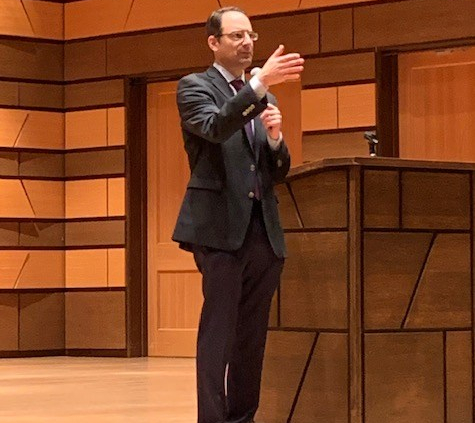 Attorney General Phil Weiser gestures while speaking at CSU's University Center for the Arts.